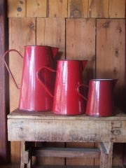 Romanian enamel jugs in four, two and one litre sizes.