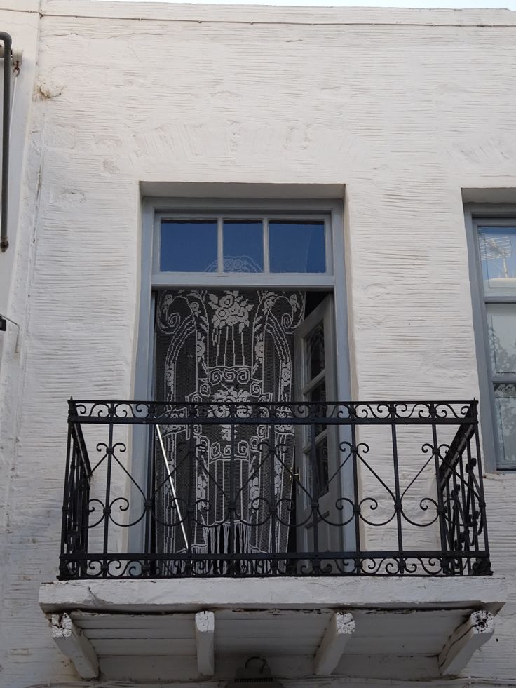 The ironwork and lace curtains