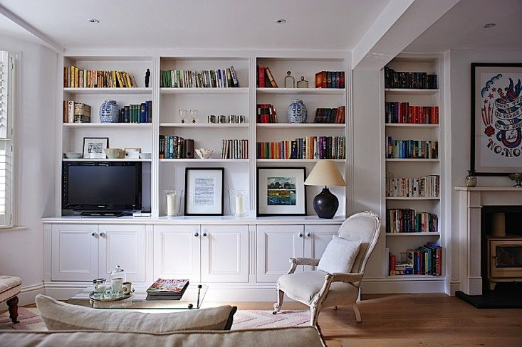 White built in bookshelves and cabinets in Isabel and George Blunden London renovation   Remodelista