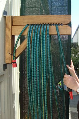 Best 25 hose reel ideas on pinterest wood reels ideas for Diy garden hose storage