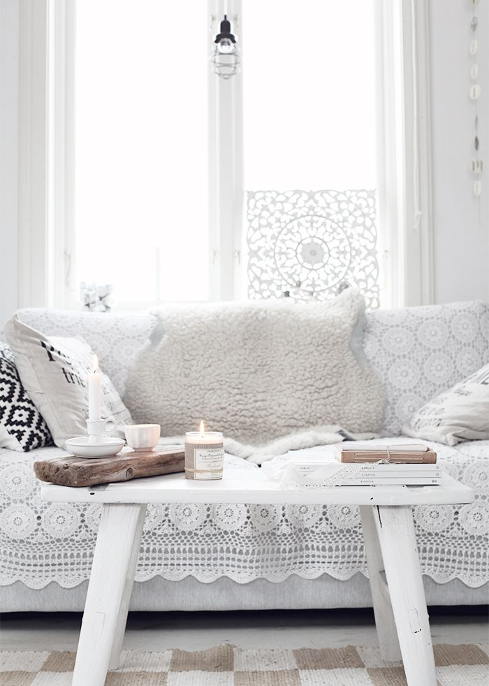 This seating set-up is so dreamy. To get the look, get a white sofa, white coffee table, and a crochet blanket.