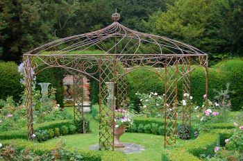 Cast iron pergola  / repinned by Llewellyn Landscape & Garden Design www.llgd.co.uk - design   create   maintain