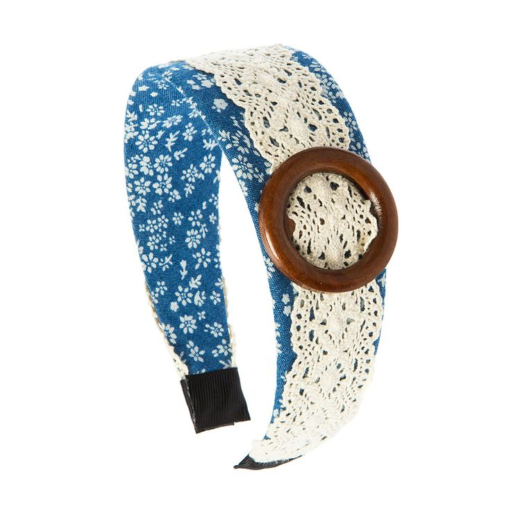 <P>Casual and homey. This headband has ivory crochet overlaying a floral denim print headband that is accented with a brown wood circle buckle.</P><UL><LI>Floral and crochet design<LI>Wide band</LI></UL>