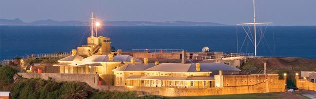 Fort Scratchley by night under lights