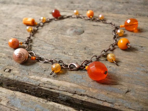 Orange bead anklet handmade by reccabella --------------------------------------------------------------  A lovely warm orange bead anklet made from a varied collection of beads in different shapes, sizes and varying shades of orange. This ankle bracelet would make a perfect piece for your holidays. The beads are hung on a oval belcher chain in antique bronze effect with a lobster clasp.   SIGN UP TO MY MAILING LIST FOR AN INSTANT 10% OFF COUPON! http://eepurl.com/cuo8w1  DETA...