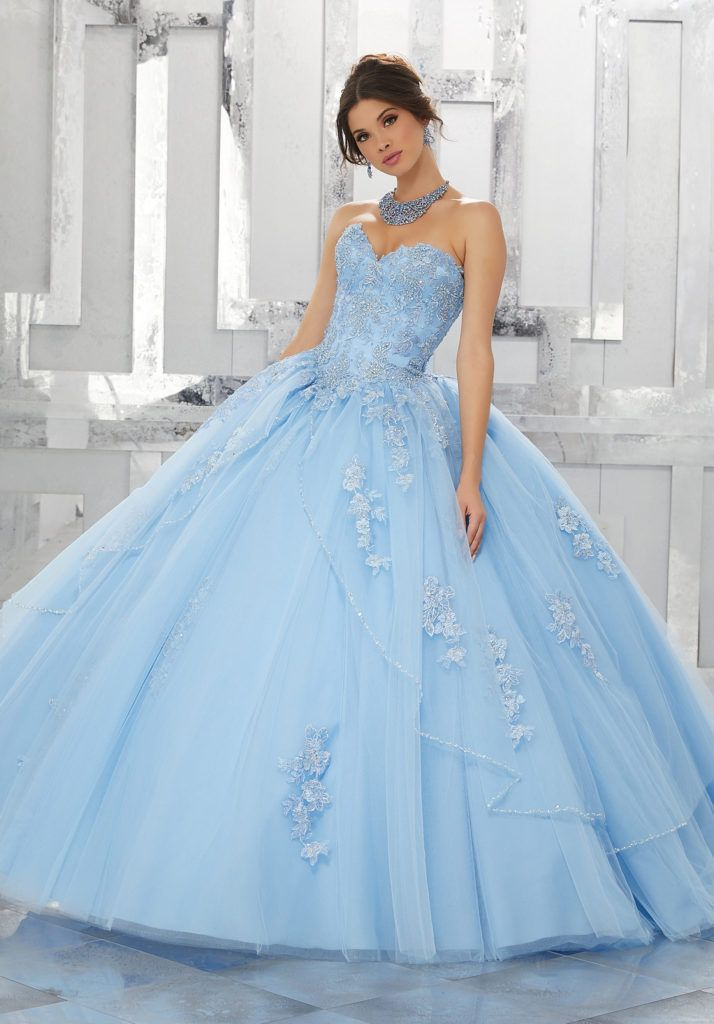 Princess Perfect, This Tulle Quinceañera Ballgown with Beaded Apron Skirt Features a Sweetheart Neckline and Lace Appliqué Details. Matching Bolero Jacket Included. Colors Available: Capri, Bubble, Light Purple, White.