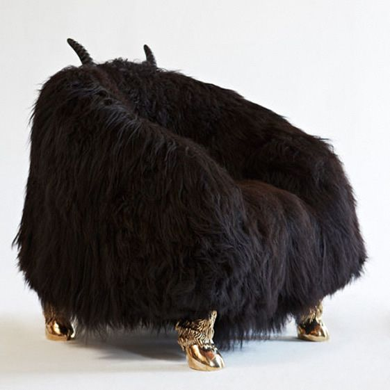 Some of this fun furniture isn't for the shy and retiring type, with ostentatious gold legs poking out from under massive furballs, but in comparison the crocodile table is understated, and the vases positively ascetic...