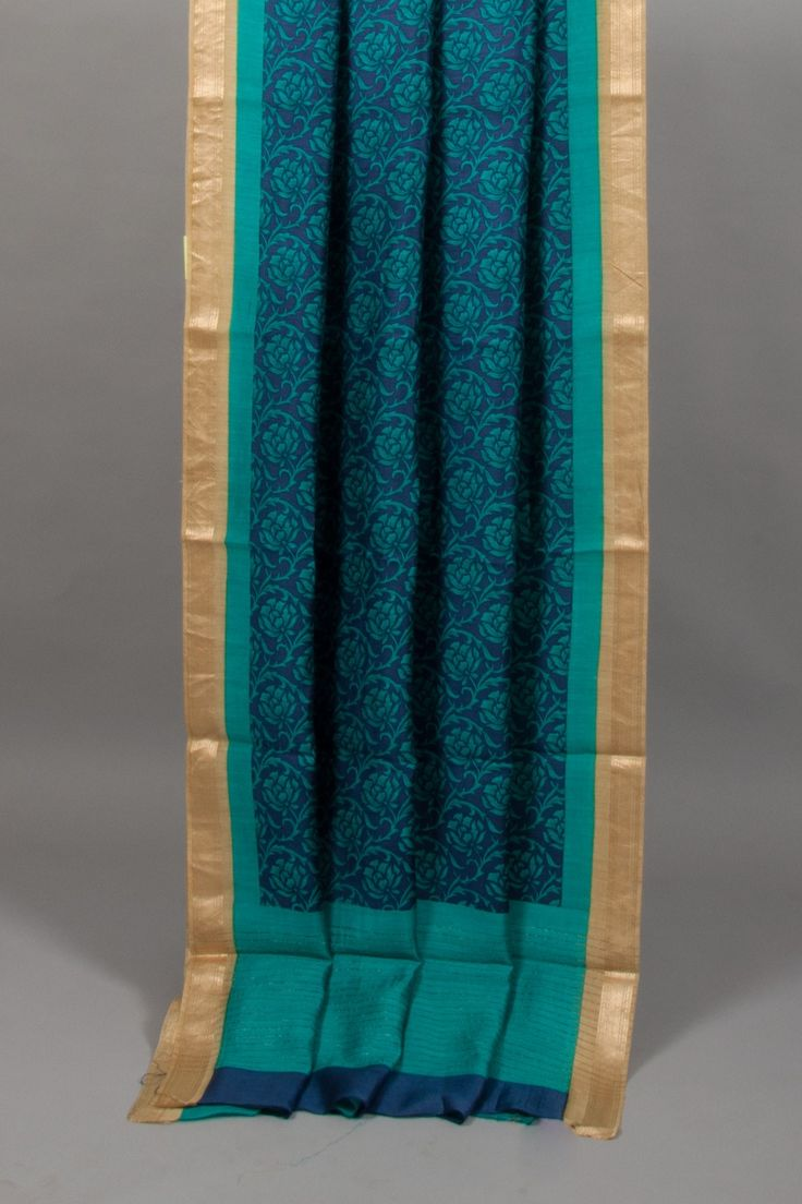 Blue soft tussar saree having designs all over the body with blue pallu and golden border.