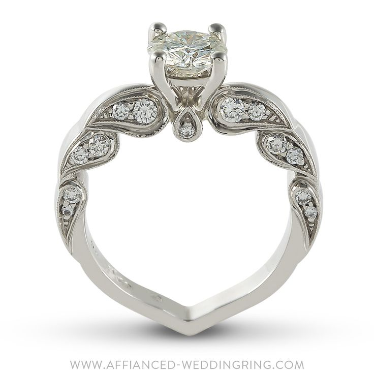 Uniquely designed white gold engagement ring decorated with center 1ct diamond 24 pcs small diamonds.