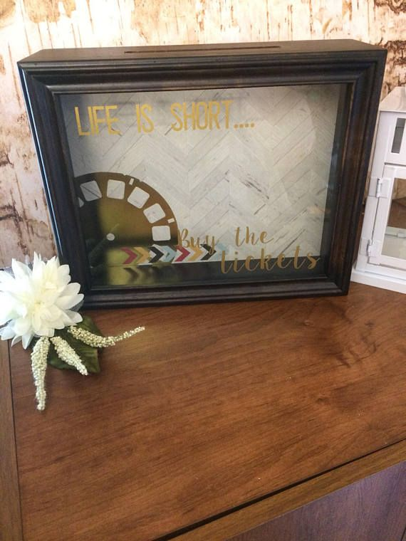 icket shadow box - ticket stub holder with vinyl decal Are your ticket stubs lying in an unsightly pile on your dresser? Or are they shoved in a shoe box in your closet? This ticket stub holder is a quick and easy solution to that problem. Simply fill box with all the ticket stubs you