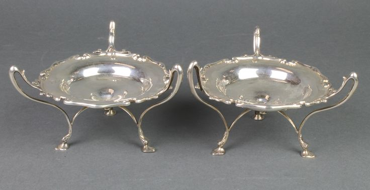 Lot 690, A pair of Edwardian silver 3 handled tazzas with cut borders, London 1908, est  £180-220