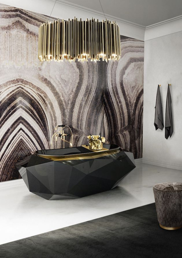 Unique bathroom design with a black bathtub, beautiful chandelier and a white marble floor  #marble #floor #bathroom #interior #naturalstone