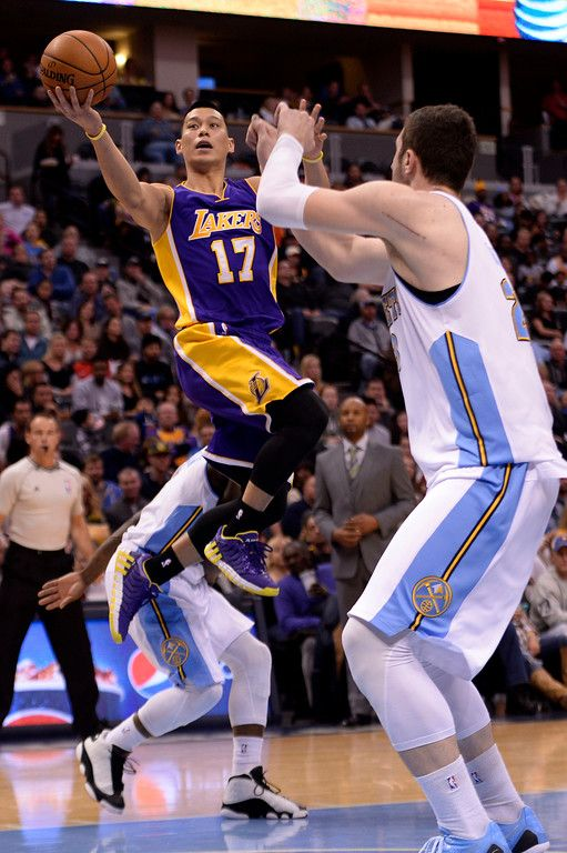 Description of . DENVER, CO - DECEMBER 30: Jeremy Lin (17) of the Los Angeles Lakers attempts a layup as Jusuf Nurkic (23) of the Denver Nuggets defends during the second half of the Lakers' 111-103 win. The Denver Nuggets hosted the Los Angeles Lakers at the Pepsi Center on Monday, December 30, 2014. (Photo by AAron Ontiveroz/The Denver Post)