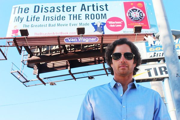 Greg Sestero in front of 'The Room' billboard in Los Angeles, California.