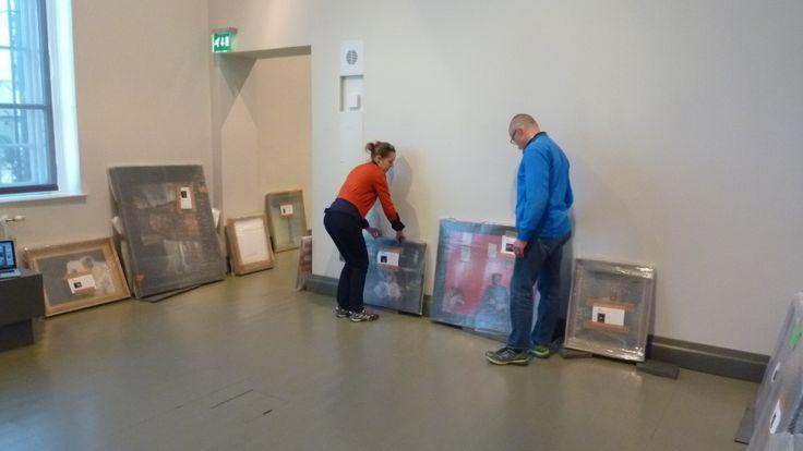 Artist Esko Männikkö and curator Maija Koskinen working with the installation
