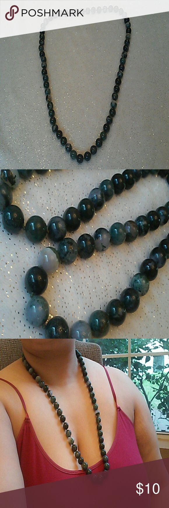 Charming charlie jade beaded necklace Medium length, jade marbled beads. Charming Charlie Jewelry Necklaces