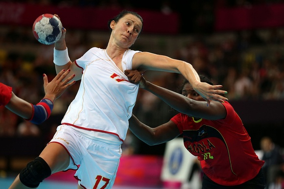 Bojana Popovic of Montenegro attempts to throw in her Women's Handball Preliminaries Group A match against Angola on Day 5 of the London 2012 Olympic Games at The Copper Box on August 1, 2012 in London, England. (Photo by Jeff J Mitchell/Getty Images)