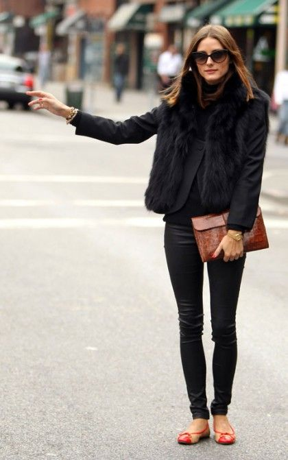 Add a touch of color with a brown clutch and red flats to an all-black outfit like Olivia Palermo