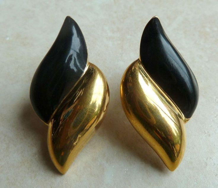 A lovely pair of Napier earrings in yellow black and gold tone metal.  Screw back fastening. Marked to the backs with Napier.  Circa early 1990's.  A stylish modern pair on the cusp of vintage.