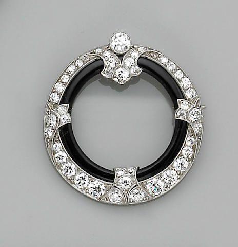 An art deco black onyx, diamond and platinum brooch