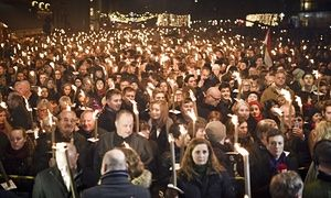 People attend a vigil for Paris attack victims in front of the French Embassy on November 15, 2015 in Copenhagen.