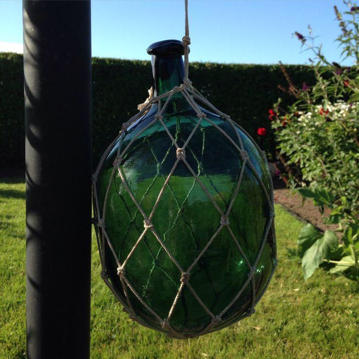 Glass fishing float, bottleshaped