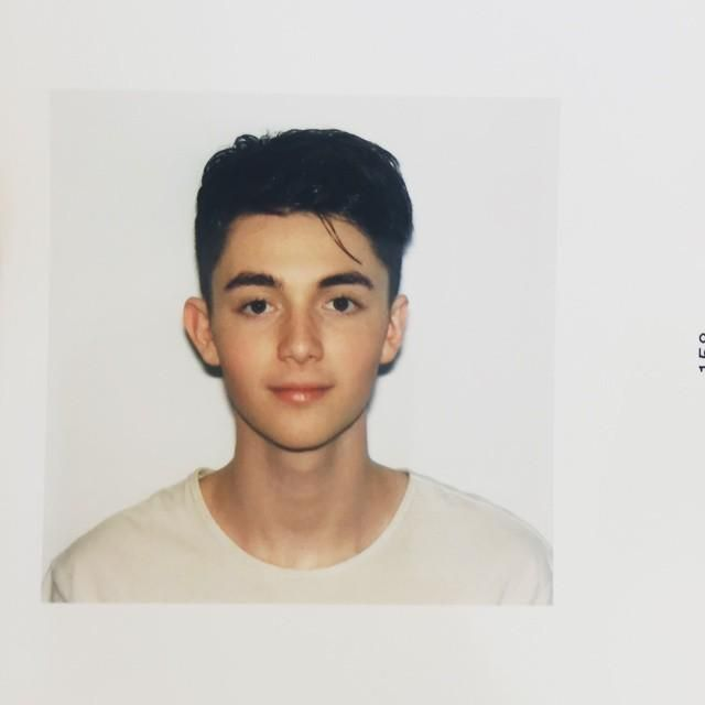 "Greyson: My new passport photo. I think I nailed the required ""natural smile"""