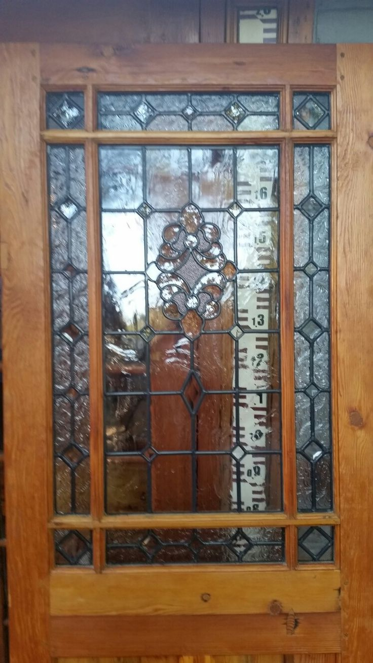 """New """"Happy door"""" made up as a front door with new Stained glass."""