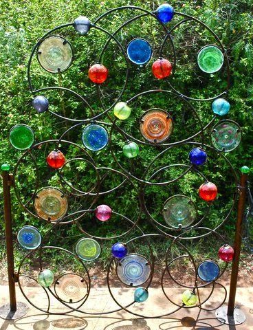 Need a garden gate? GREAT USE OF BOTTLE BOTTOMS CUT OFF BOTTLES USED FOR OTHER PROJECTS.
