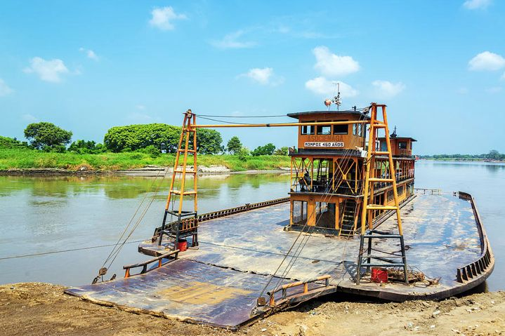 Description. Old historic ferry waiting to take passenger along the Magdalena River to and from Mompox, Colombia