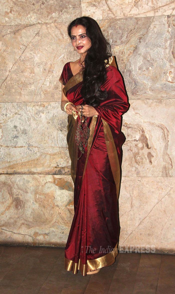 Rekha looked beautiful in a maroon sari with a gold border at the 'Ram-Leela' screening. #Bollywood #Fashion #Style #Beauty
