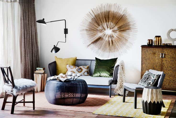 Round Black metal coffee table as seen in Belle magazine