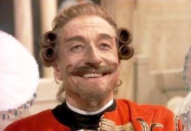 John Neville as Baron Munchausen