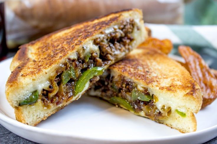 Ground Philly Cheesesteak Grilled Cheese with bell peppers, onions and American or Provolone Cheese. All the flavor of a cheese steak for half the price.
