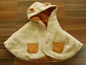 Selimut bayi motif coklat. Bulunya tebel kayak shaun the sheep.. ehhhh