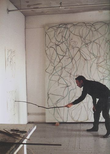 Brice Marden drawing with stick