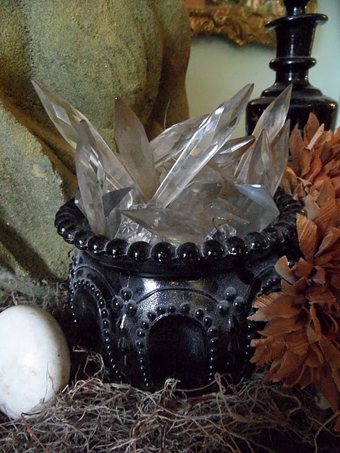 Antique chandelier prisms cast their spooky spell in this ornate miniature black cauldron.