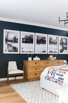 Long wall of black and white photos - love this alternative to the more common gallery wall