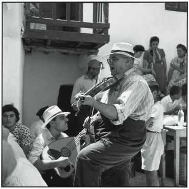 Robert McCabe, Mykonos 1955.  Musicians at a baptismal festival, 1955  Robert McCabe Greece: Images of an Enchanted Land, 1954-1965 http://mccabephotos.com/