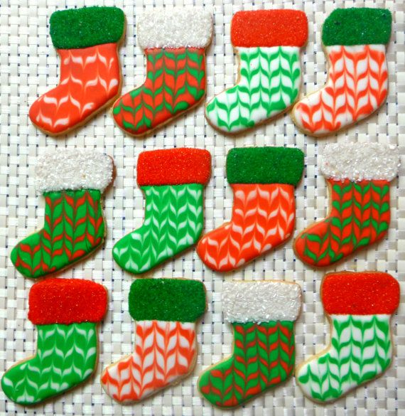 Christmas stocking decorated sugar cookie. Royal icing. Red, green, white. Marbled, sanding sugar, sparkling sugar.