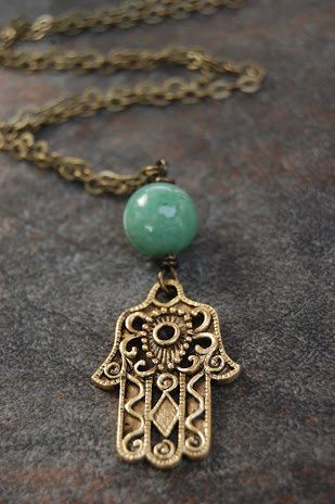 The hamsa is an ancient Middle Eastern amulet symbolizing the Hand of God. It is a protective sign, bringing its owner happiness, luck, health,