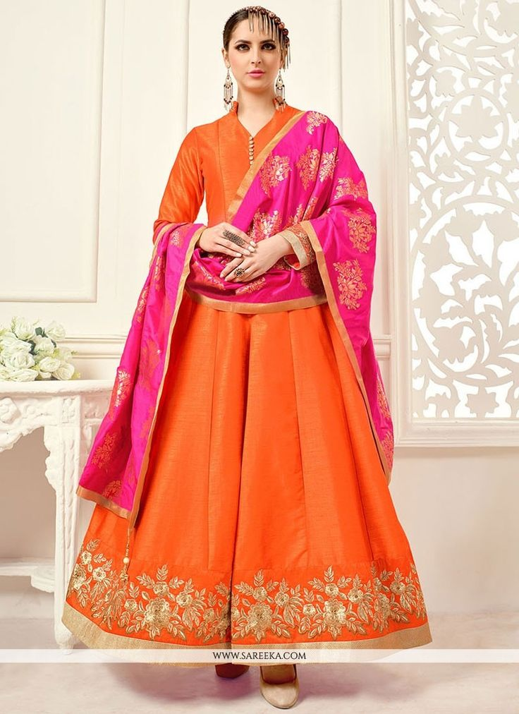 Add the sense of feminine beauty by this hot pink and orange banglori silk floor length anarkali suit. Beautified with embroidered and lace work all synchronized nicely through the trend and design of...
