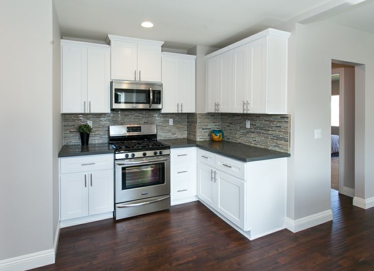 grey kitchen cabinets with white appliances modern kitchen with warm wood floors gray paint white 16101