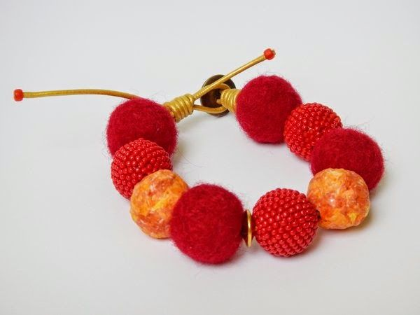 Red bracelet with beaded beads, felted beads and paper beads