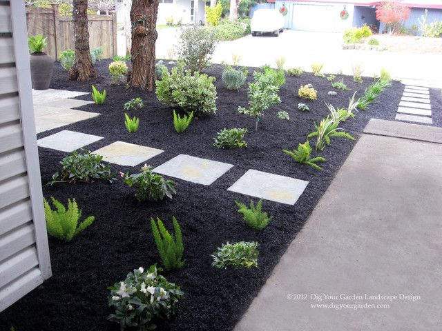 Black mulch with pavers - side yard.                                                                                                                                                                                 More