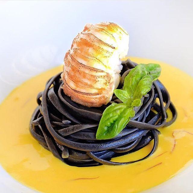 Butter poached lobster, squid ink pasta, saffron sauce. ✅ By - @chef_bryanjimenez ✅  #ChefsOfInstagram