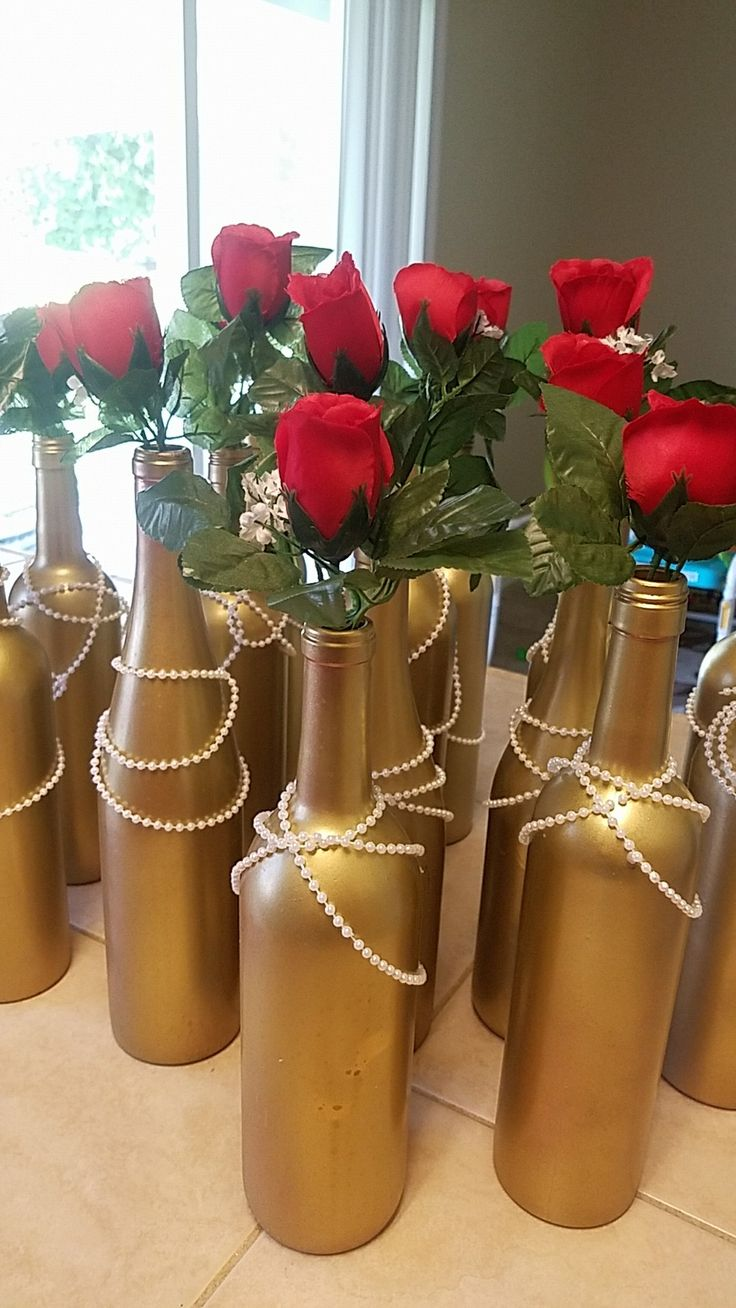 Great Gatsby themed 50th birthday centerpieces, gold with pearls and red roses