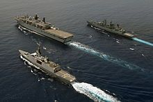 HMS Bulwark (L15) - Wikipedia. Escorted by the French frigate Courbet and German frigate Schleswig-Holstein during IMCMEX14 in the Persian Gulf