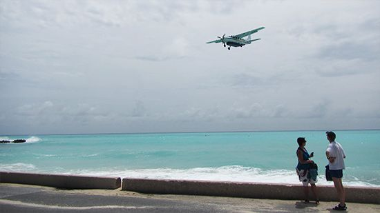 """Regional airline, St. Barth Commuter as it descends into Princess Juliana International Airport (SXM) 