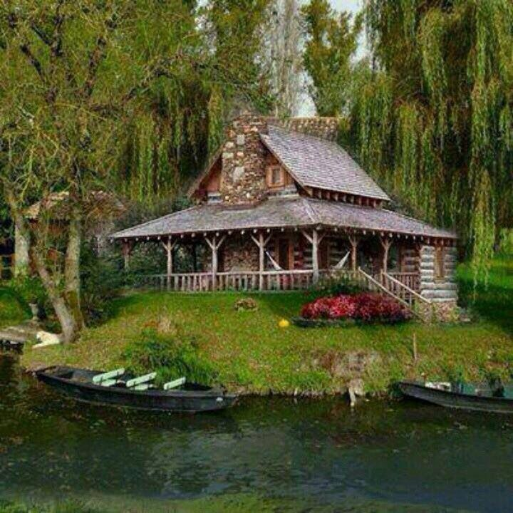 Log cabin with wrap around porch on the lake. Good place to set up all my LOTR fandom.